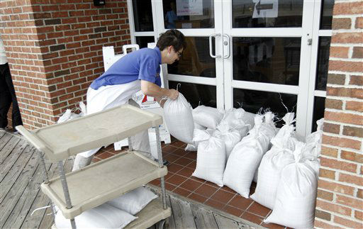 "<div class=""meta ""><span class=""caption-text "">A restaurant worker piles sand bags at the entrance of the business as Hurricane Sandy approaches the Atlantic Coast, in Ocean City, Md., on Saturday, Oct. 27, 2012.  (AP Photo/ Jose Luis Magana)</span></div>"