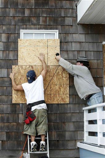 "<div class=""meta ""><span class=""caption-text "">Workers Shannon Alexander, left, and Don Bruce board up the windows of an apartment building as Hurricane Sandy approaches the Atlantic Coast, in Ocean City, Md., on Saturday, Oct. 27, 2012.  (AP Photo/ Jose Luis Magana)</span></div>"
