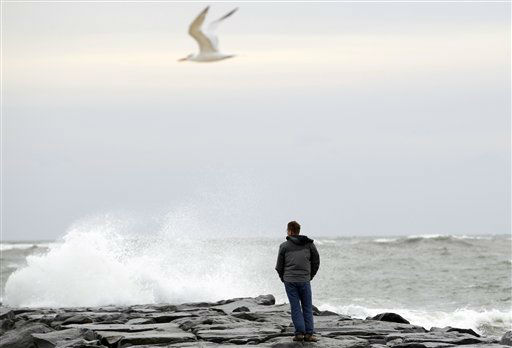 "<div class=""meta ""><span class=""caption-text "">Resident Brian Dougherty looks at the waves from the beach in Ocean City, Md., as Hurricane Sandy approaches the Atlantic Coast, on Saturday, Oct. 27, 2012.  (AP Photo/ Jose Luis Magana)</span></div>"