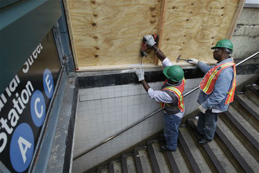 Metropolitan Transportation Authority workers cover an entrance to the Canal Street A, C, and E station with plywood to help prevent flooding, Saturday, Oct. 27, 2012, in New York.  <span class=meta>(AP Photo&#47; Mary Altaffer)</span>