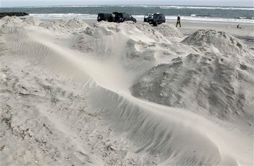 As men surf fish near the ocean, sand blows  on mounds for beach protection in North Wildwood, N.J., Saturday, Oct. 27, 2012, as the area prepares for Hurricane Sandy.  <span class=meta>(AP Photo&#47; Mel Evans)</span>