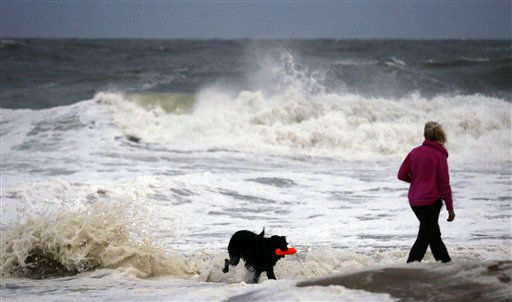 "<div class=""meta ""><span class=""caption-text "">Annemarie Jarman, and her dog ""Bruges,"" walk along the edge of the beach that is mostly empty as Hurricane Sandy bears down on the east coast, Saturday, Oct. 27, 2012, in Ocean City, Md.  (AP Photo/ Alex Brandon)</span></div>"