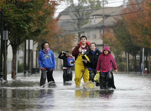 People carry personal belongings from their home in the wake of superstorm Sandy on Tuesday, Oct. 30, 2012, in Little Ferry, N.J.  <span class=meta>(AP Photo&#47; Mike Groll)</span>