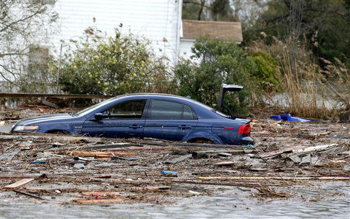A vehicle is seen in floodwaters the morning after hybrid storm Sandy rolled through, Tuesday, Oct. 30, 2012, in Brick, N.J.  <span class=meta>(AP Photo&#47; Julio Cortez)</span>