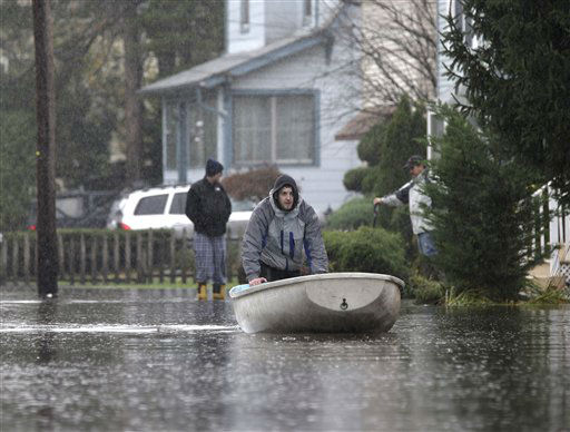 A man pushes a boat along a flooded street in the wake of Superstorm Sandy on Tuesday, Oct. 30, 2012, in Little Ferry, N.J. <span class=meta>(AP Photo&#47; Mike Groll)</span>