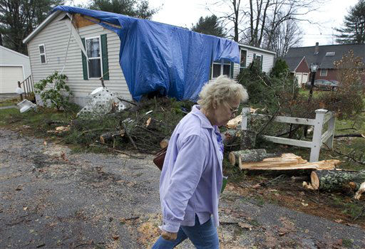 Jan Wales leaves her home after returning to pick up some belongings, Tuesday, Oct. 30, 2012, Buxton, Maine.  <span class=meta>(AP Photo&#47; Robert F Bukaty)</span>