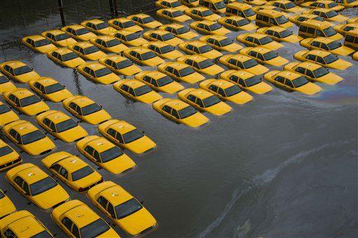 "<div class=""meta ""><span class=""caption-text "">A parking lot full of yellow cabs is flooded as a result of superstorm Sandy on Tuesday, Oct. 30, 2012 in Hoboken, NJ. (AP Photo/ Charles Sykes)</span></div>"