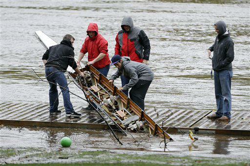 Members of the Saint Joseph&#39;s University crew team pull a damaged boat from the Schuylkill river in the wake of superstorm Sandy, Tuesday, Oct. 30, 2012, in Philadelphia.  <span class=meta>(AP Photo&#47; Matt Slocum)</span>
