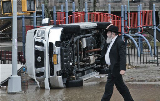 "<div class=""meta ""><span class=""caption-text "">A van is flipped on its side in the aftermath of flooding caused by superstorm Sandy on Tuesday, Oct. 30, 2012, in the Coney Island section of the Brooklyn borough of New York. (AP Photo/ Bebeto Matthews)</span></div>"