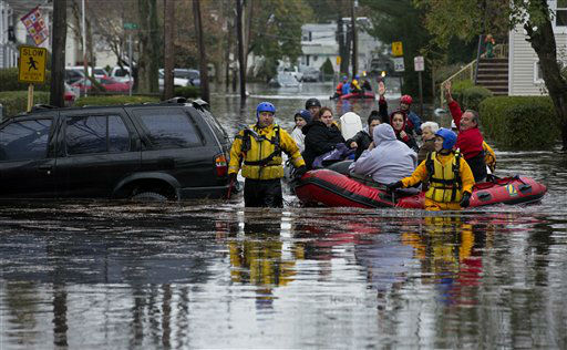 People, some waving to those on dry ground, are rescued by boat in Little Ferry, N.J. Tuesday, Oct. 30, 2012 in the wake of superstorm Sandy.  <span class=meta>(AP Photo&#47; Craig Ruttle)</span>