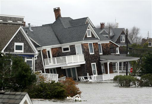 Floodwaters surround homes near the Mantoloking Bridge the morning after superstorm Sandy rolled through, Tuesday, Oct. 30, 2012, in Mantoloking, N.J.  <span class=meta>(AP Photo&#47; Julio Cortez)</span>