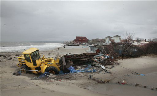 A front end loader clears debris caught in floods and washed onto the beach near the Seaview community in the aftermath of superstorm Sandy on Tuesday, Oct. 30, 2012, in Coney Island, N.Y.  <span class=meta>(AP Photo&#47; Bebeto Matthews)</span>