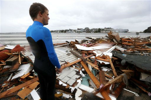 Currie Wagner looks over the debris from his grandmother Betty Wagner&#39;s house, which was destroyed and wound atop the Mantoloking Bridge the morning after superstorm Sandy rolled through, Tuesday, Oct. 30, 2012, in Mantoloking, N.J.  <span class=meta>(AP Photo&#47; Julio Cortez)</span>