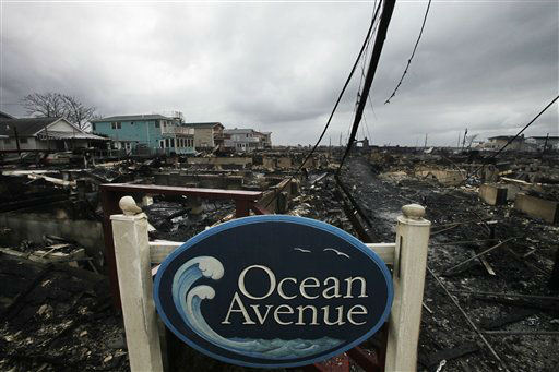 A sign for Ocean Avenue stands in the smoldering ruins of houses in the Breezy Point section of New York, Tuesday, Oct. 30, 2012.  <span class=meta>(AP Photo&#47; Mark Lennihan)</span>