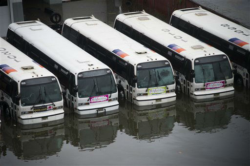 A parking lot full of buses is flooded as a result of superstorm Sandy on Tuesday, Oct. 30, 2012 in Hoboken, NJ.  <span class=meta>(AP Photo&#47; Charles Sykes)</span>