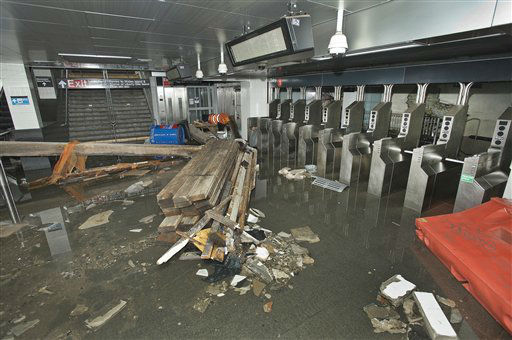 This photo provided by the Metropolitan Transportation Authority shows the South Ferry subway station after it was flooded by seawater during superstorm Sandy on Tuesday, Oct. 30, 2012.