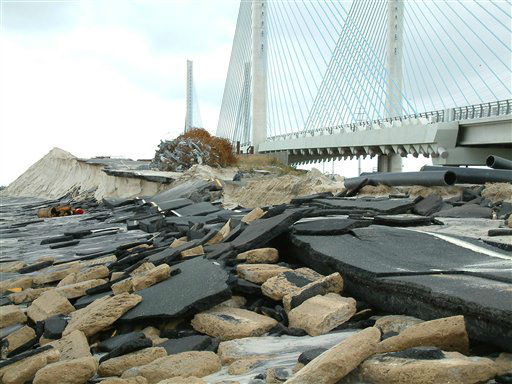 Storm-driven waves from superstorm Sandy destroyed an approach road to the old bridge spanning the Indian River Inlet in southern Delaware. The new bridge, seen in the background, was undamaged but remained closed to traffic Tuesday, Oct.30, 2012, after waves destroyed hundreds of yards of beach dunes and left state Route 1 covered with sand.  <span class=meta>(AP Photo&#47; Randall Chase)</span>