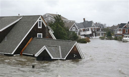 Floodwaters surround homes near the Mantoloking...