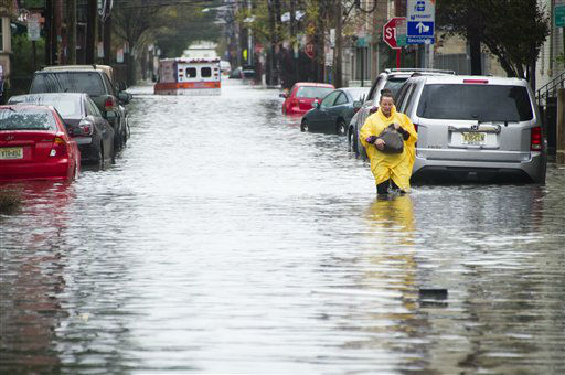 A resident walks through flood water and past a stalled ambulance in the  aftermath of superstorm Sandy on Tuesday, Oct. 30, 2012 in Hoboken, NJ.  <span class=meta>(Photo&#47;Charles Sykes)</span>