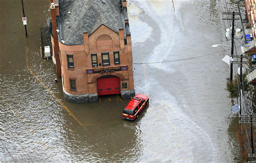 A firehouse is surrounded by floodwaters in the wake of superstorm Sandy on Tuesday, Oct. 30, 2012, in Hoboken, N.J.