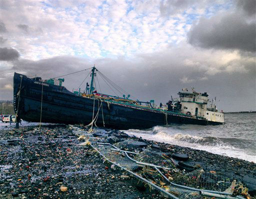 "<div class=""meta ""><span class=""caption-text "">A 168-foot water tanker, the John B. Caddell, sits on the shore Tuesday morning, Oct. 30, 2012 where it ran aground on Front Street in the Stapleton neighborhood of New York's Staten Island as a result of superstorm Sandy.  (AP Photo/ Sean Sweeney)</span></div>"