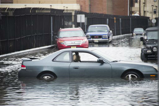 Cars sit in flood water as a result of superstorm Sandy on Tuesday, Oct. 30, 2012 in Hoboken, NJ.