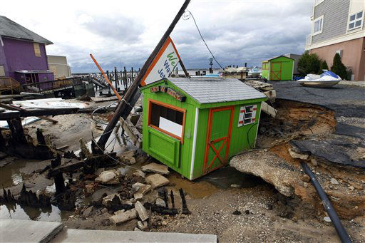 A small shop that rents personal water craft rests in a huge sinkhole on the bayside in Ocean City, N.J. Tuesday, Oct. 30, 2012 after a storm surge from superstorm Sandy Monday night.  <span class=meta>(AP Photo&#47; Mel Evans)</span>