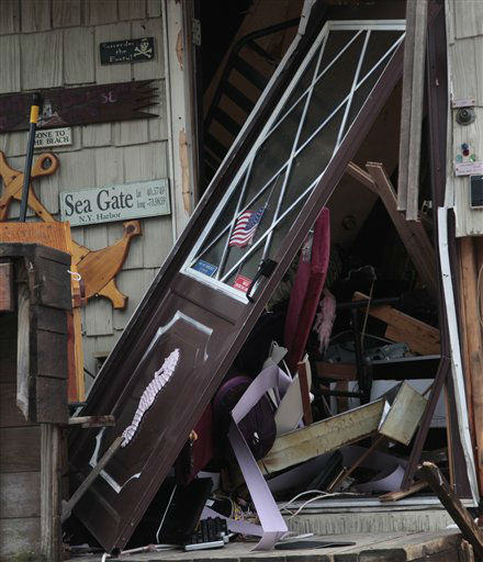 "<div class=""meta ""><span class=""caption-text "">The entrance to a beachfront house is destroyed in the aftermath of a storm surge from superstorm Sandy, Tuesday, Oct. 30, 2012, in Coney Island's Sea Gate community in New York.  (AP Photo/ Bebeto Matthews)</span></div>"