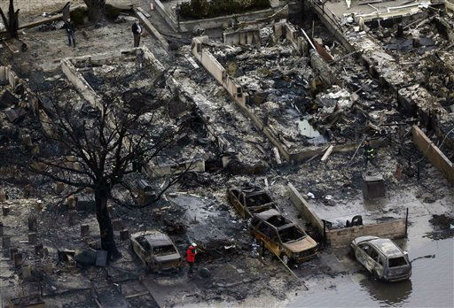 This aerial photo shows burned-out homes in the...