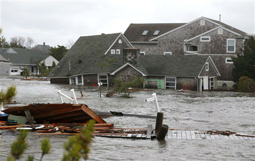 Floodwaters surround homes near the Mantoloking Bridge the morning after hybrid storm Sandy rolled through, Tuesday, Oct. 30, 2012, in Mantoloking, N.J.  <span class=meta>(AP Photo&#47; Julio Cortez)</span>