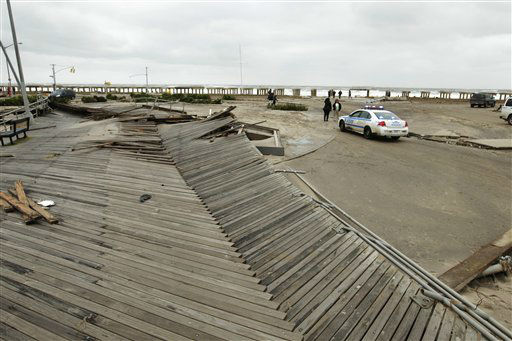 "<div class=""meta ""><span class=""caption-text "">Pedestrians asses the damage from flooding near Rockaway Beach in the New York City borough of Queens Tuesday, Oct. 30, 2012, in New York.  (AP Photo/ Frank Franklin II)</span></div>"