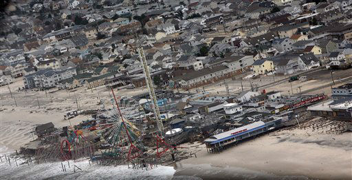 This photo made available by the New Jersey Governor's Office shows damage to the boardwalk in Seaside Heights, N.J. on Tuesday, Oct. 30, 2012 after superstorm Sandy made landfall in New Jersey Monday evening.