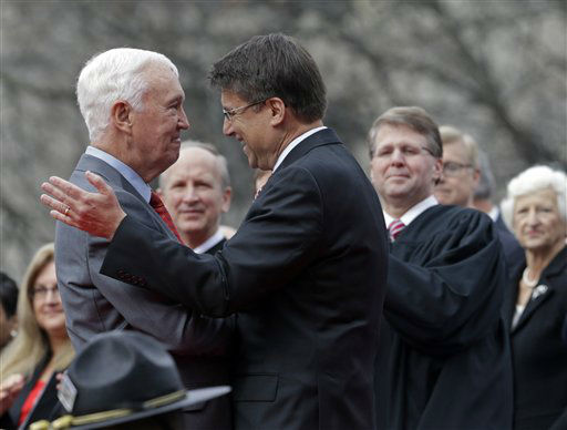 North Carolina Gov. Pat McCrory, right, is greeted by former Lt. Gov. Jim Gardner, left, before McCrory takes the oath of office during the inaugural ceremony at the state Capitol in Raleigh, N.C., Saturday, Jan. 12, 2013.  <span class=meta>(AP Photo&#47; Gerry Broome)</span>