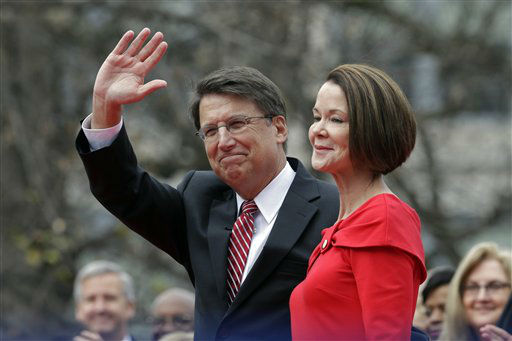 "<div class=""meta image-caption""><div class=""origin-logo origin-image ""><span></span></div><span class=""caption-text"">North Carolina Gov. Pat McCrory and his wife Ann greet the public after McCrory took the oath of office during the inaugural ceremonies at the state Capitol in Raleigh, N.C., Saturday, Jan. 12, 2013.   (AP Photo/ Gerry Broome)</span></div>"