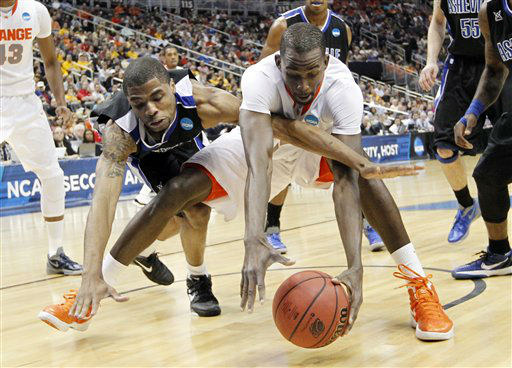 UNC-Asheville&#39;s Jaron Lane, left, and Syracuse&#39;s Baye Keita, reach for a loose ball in the first half of an East Regional NCAA tournament second-round college basketball game on Thursday, March 15, 2012, in Pittsburgh.  <span class=meta>(AP Photo&#47; Keith Srakocic)</span>