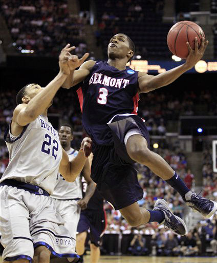 Georgetown&#39;s Otto Porter &#40;22&#41; fouls Belmont&#39;s Kerron Johnson &#40;3&#41; during the second half of an NCAA men&#39;s college basketball tournament second-round game in Columbus, Ohio, Friday, March 16, 2012. Georgetown won 74-59.  <span class=meta>(AP Photo&#47; Tony Dejak)</span>