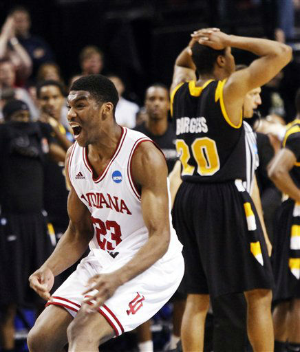 Indiana guard Remy Abell, left, celebrates as Virginia Commonwealth&#39;s Bradford Burgess walks away after Indiana&#39;s 63-61 win in their NCAA tournament third-round college basketball game in Portland, Ore., Saturday, March 17, 2012.  <span class=meta>(AP Photo&#47; Don Ryan)</span>