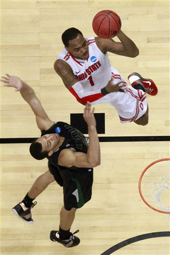 "<div class=""meta ""><span class=""caption-text "">Loyola of Maryland's Erik Etherly, left, fouls Ohio State's Deshaun Thomas (1)during the second half of an East Regional NCAA tournament second-round college basketball game in Pittsburgh, Thursday, March 15, 2012. Ohio State won 78-59.  (AP Photo/ Gene J. Puskar)</span></div>"