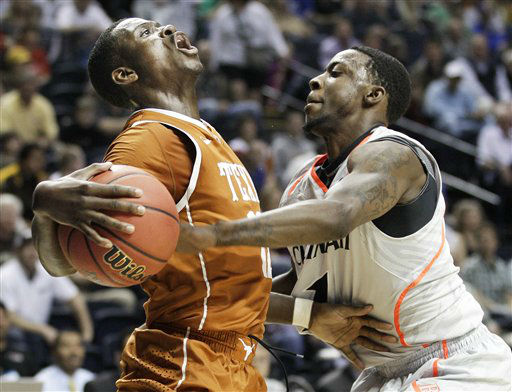 Texas guard Myck Kabongo, left, collides with Cincinnati guard Cashmere Wright, right, while driving to the basket in the first half of an NCAA college basketball tournament game on Friday, March 16, 2012, in Nashville, Tenn.  <span class=meta>(AP Photo&#47; Mark Humphrey)</span>