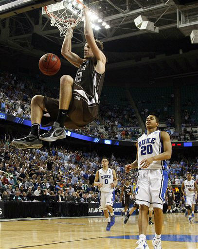 Lehigh&#39;s Gabe Knutson dunks as Duke&#39;s Andre Dawkins &#40;20&#41; watches during the second half of an NCAA tournament second-round college basketball game in Greensboro, N.C., Friday, March 16, 2012. Lehigh won 75-70.  <span class=meta>(AP Photo&#47; Gerry Broome)</span>