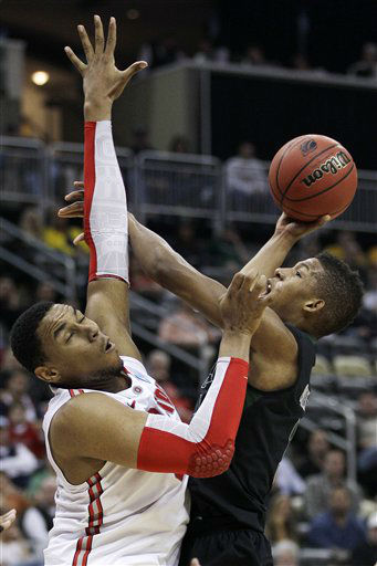 "<div class=""meta ""><span class=""caption-text "">Loyola of Maryland's Dylon Cormier, right, cannot get a shot over Ohio State's Jared Sullinger during the first half of an NCAA tournament second-round college basketball game in Pittsburgh, Thursday, March 15, 2012. (AP Photo/ Gene J. Puskar)</span></div>"