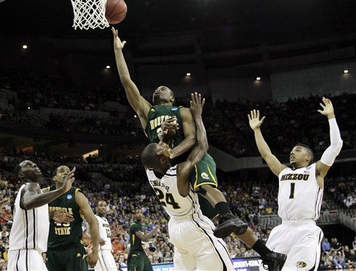 Norfolk State&#39;s Brandon Wheeless, top, fouls Missouri&#39;s Kim English on his way to the basket in the second half of an NCAA tournament second-round college basketball game at CenturyLink Center in Omaha, Neb., Friday, March 16, 2012. Norfolk State won 86-84.  <span class=meta>(AP Photo&#47; Orlin Wagner)</span>
