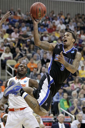 UNC-Asheville&#39;s J.P. Primm &#40;3&#41; lays up a shot in front of Syracuse&#39;s Dion Waiters during the first half of an NCAA men&#39;s college basketball tournament second-round game in Pittsburgh, Thursday, March 15, 2012.  <span class=meta>(AP Photo&#47; Gene J. Puskar)</span>