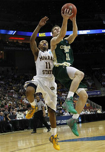 Colorado State guard Jesse Carr &#40;11&#41; goes to the basket as Murray State guard Donte Poole &#40;11&#41; defends in the first half of their NCAA tournament second-round college basketball game in Louisville, Ky., Thursday, March 15, 2012.  <span class=meta>(AP Photo&#47; Dave Martin)</span>