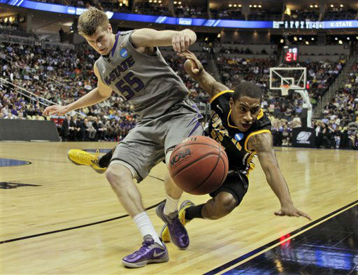 Southern Miss&#39; Neil Watson, right, collides with Kansas State&#39;s Will Spradling &#40;55&#41; during the first half of an East Regional NCAA tournament second-round college basketball game in Pittsburgh, Thursday, March 15, 2012.  <span class=meta>(AP Photo&#47; Gene J. Puskar)</span>