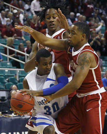 Creighton&#39;s Antoine Young, left, is trapped by Alabama&#39;s Levi Randolph, top, and Trevor Releford, right, during the first half of a Midwest Regional NCAA tournament second-round college basketball game in Greensboro, N.C., Friday, March 16, 2012.  <span class=meta>(AP Photo&#47; Gerry Broome)</span>