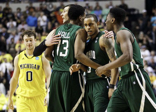 Ohio guard Walter Offutt, second from right, is congratulated by Ivo Baltic, fourth from right, T. J. Hall &#40;13&#41; and Ricardo Johnson, right, after Offutt drew a foul against Michigan in the final seconds of a second-round NCAA college basketball tournament game on Friday, March 16, 2012, in Nashville, Tenn. The resulting free throws by Offutt sealed a 65-60 win for Ohio. At left is Michigan&#39;s Zack Novak &#40;0&#41;.  <span class=meta>(AP Photo&#47; Mark Humphrey)</span>