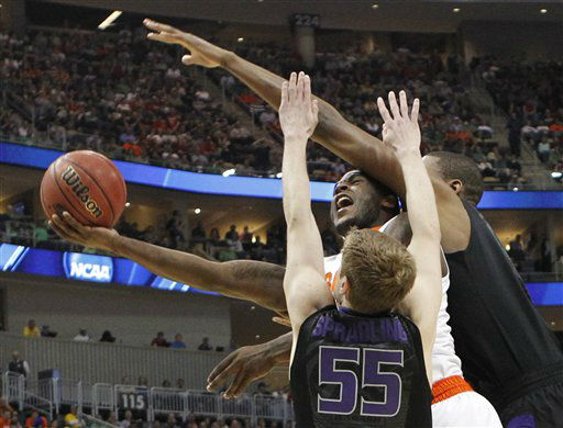 Syracuse&#39;s Dion Waiters, center, tries to shoot between Kansas State&#39;s Will Spradling &#40;55&#41; and Jordan Henriquez in the first half of an East Regional NCAA tournament third-round college basketball game on Saturday, March 17, 2012 in Pittsburgh.  <span class=meta>(AP Photo&#47; Keith Srakocic)</span>