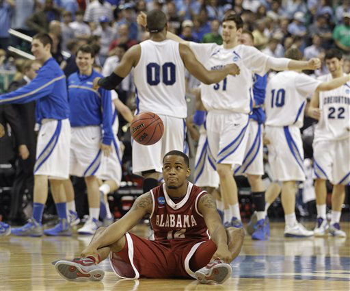 Alabama&#39;s Trevor Releford &#40;12&#41; sits on the court as Creighton players celebrate at the end of a Midwest Regional NCAA tournament second-round college basketball game in Greensboro, N.C., Friday, March 16, 2012. Creighton won 58-57.  <span class=meta>(AP Photo&#47; Chuck Burton)</span>
