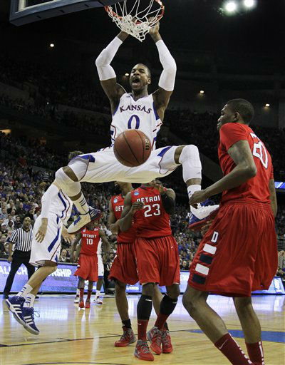 Kansas forward Thomas Robinson &#40;0&#41; dunks next to Detroit center LaMarcus Lowe &#40;20&#41; during the first half of an NCAA college basketball tournament game at CenturyLink Center in Omaha, Neb., Friday, March 16, 2012. <span class=meta>(AP Photo&#47; Nati Harnik)</span>
